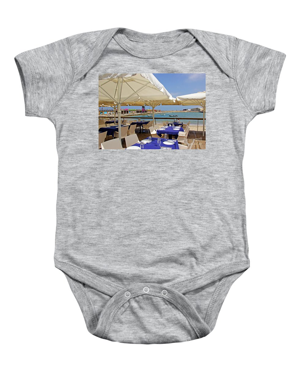 Cafe Baby Onesie featuring the photograph Cafe In White And Purple by Zal Latzkovich