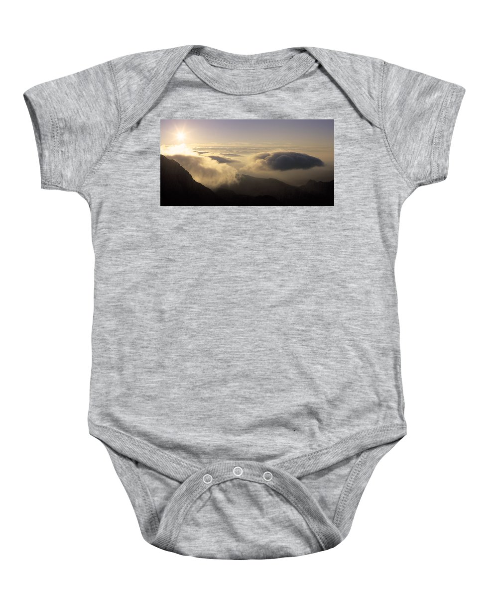 Alps Baby Onesie featuring the photograph Celestial Wanderers by Konstantin Dikovsky