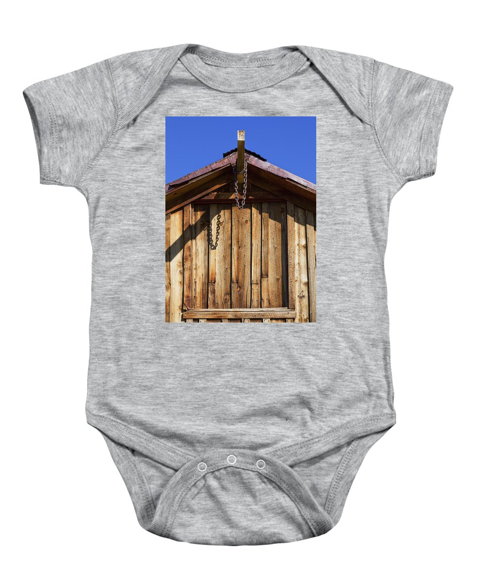 Wooden Structure Baby Onesie featuring the photograph Chain Up by Kelley King