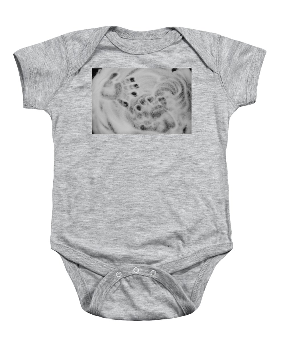 Black And White Baby Onesie featuring the photograph Child Hand Prints by Rob Hans