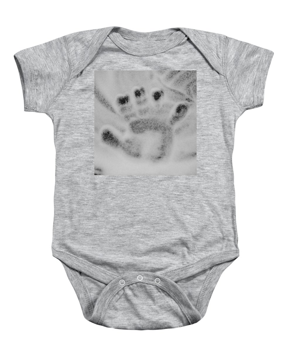 Black And White Baby Onesie featuring the photograph Childs Hand by Rob Hans