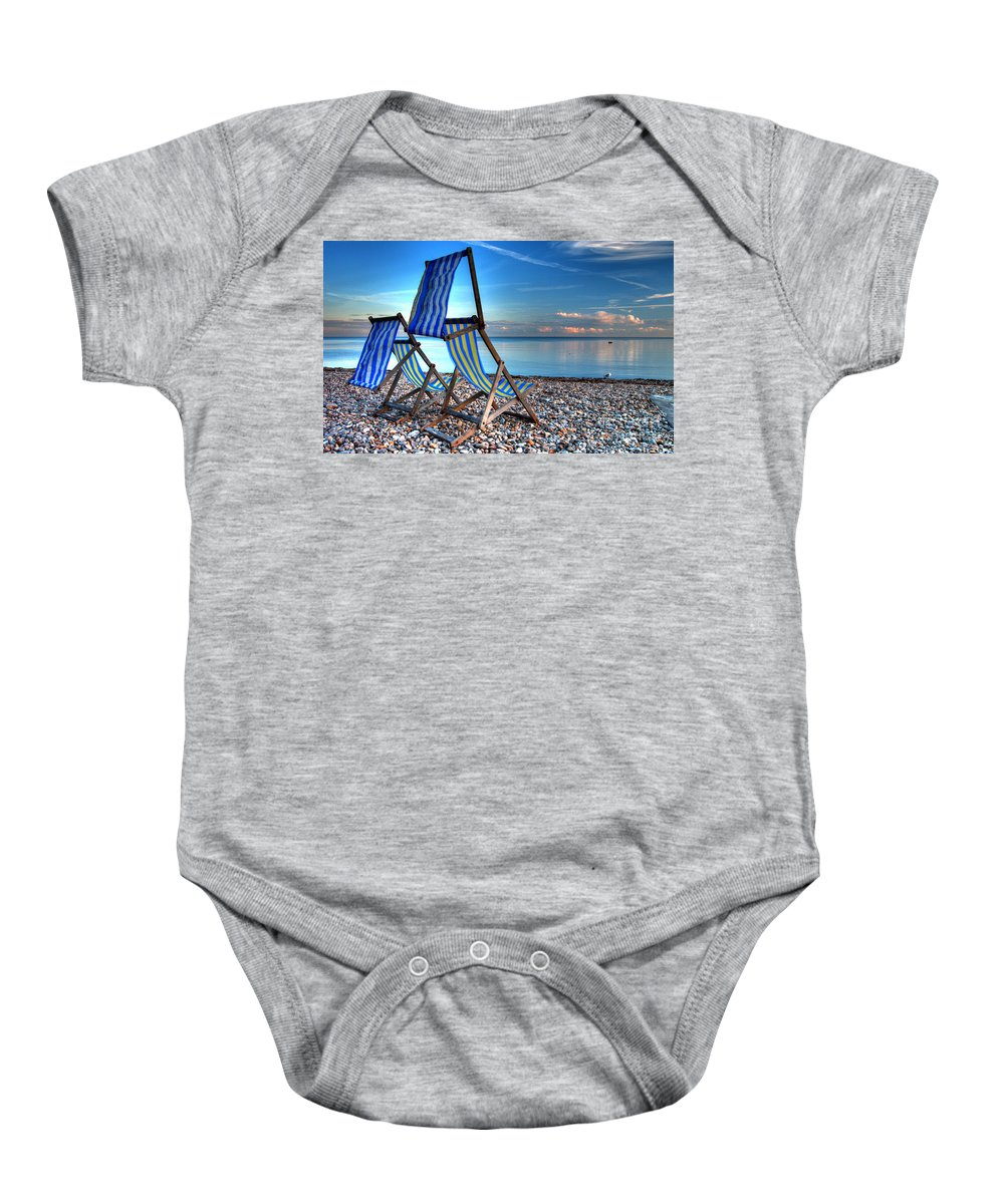 Deckchairs Baby Onesie featuring the photograph Deckchairs On The Shingle by Rob Hawkins