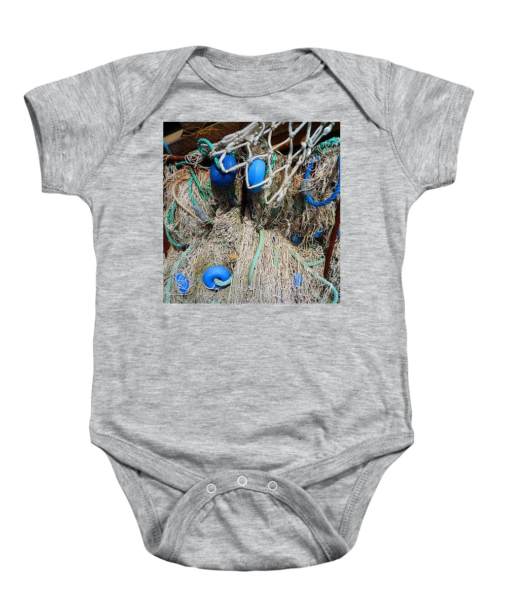 Fishing Net Baby Onesie featuring the photograph Deep Blue Discs by Charles Stuart