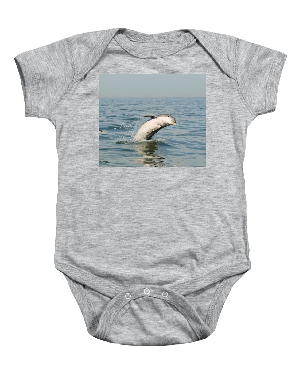 Marine Life Baby Onesie featuring the photograph Dolphin Splash by Terrie Stickle
