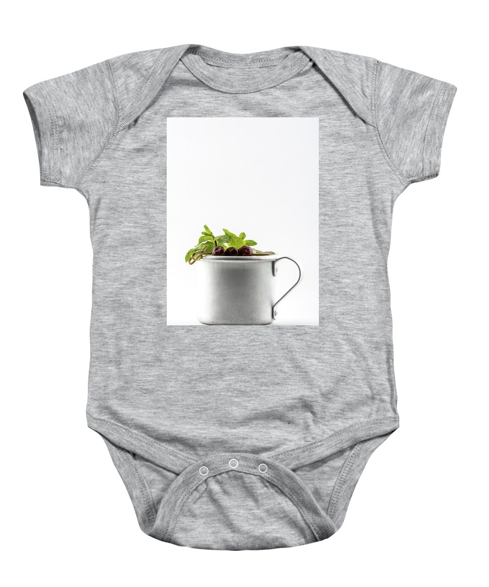 Alcohol Baby Onesie featuring the photograph Drink With Leaves Of Mint And Cherries by Oleg Yermolov