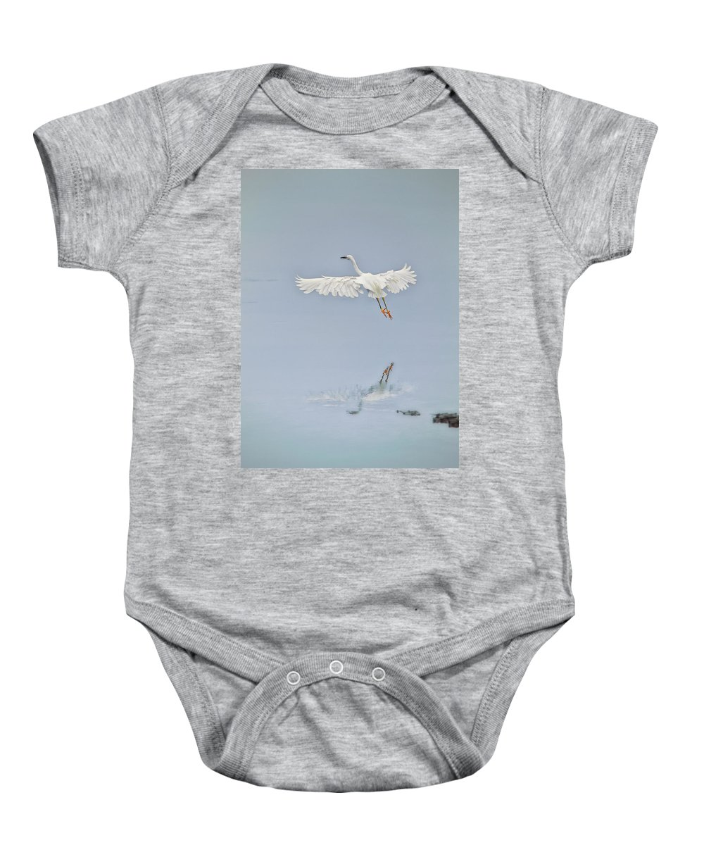 Egret Baby Onesie featuring the photograph Egret Takes Flight by Susan Gary