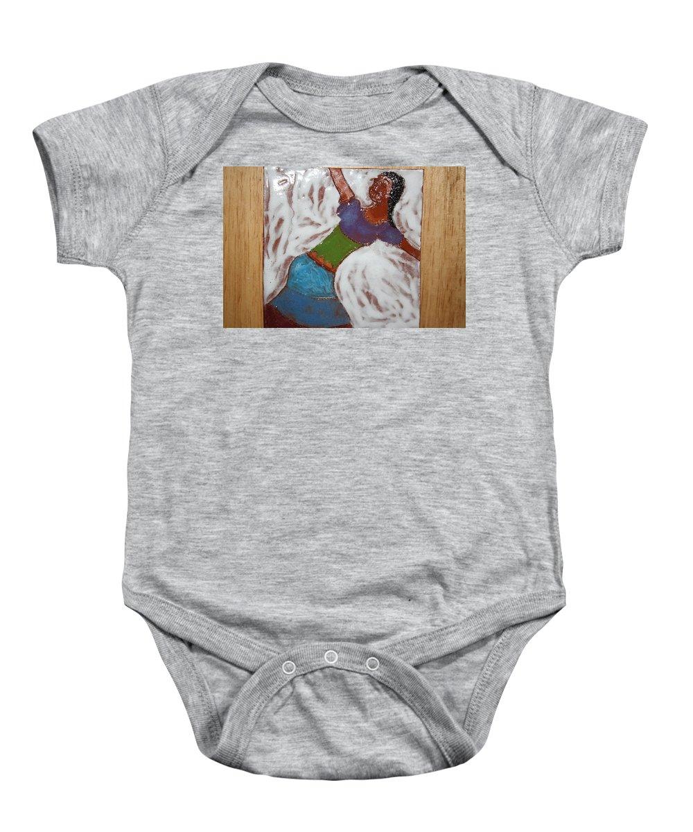 Jesus Baby Onesie featuring the ceramic art Enid - Tile by Gloria Ssali