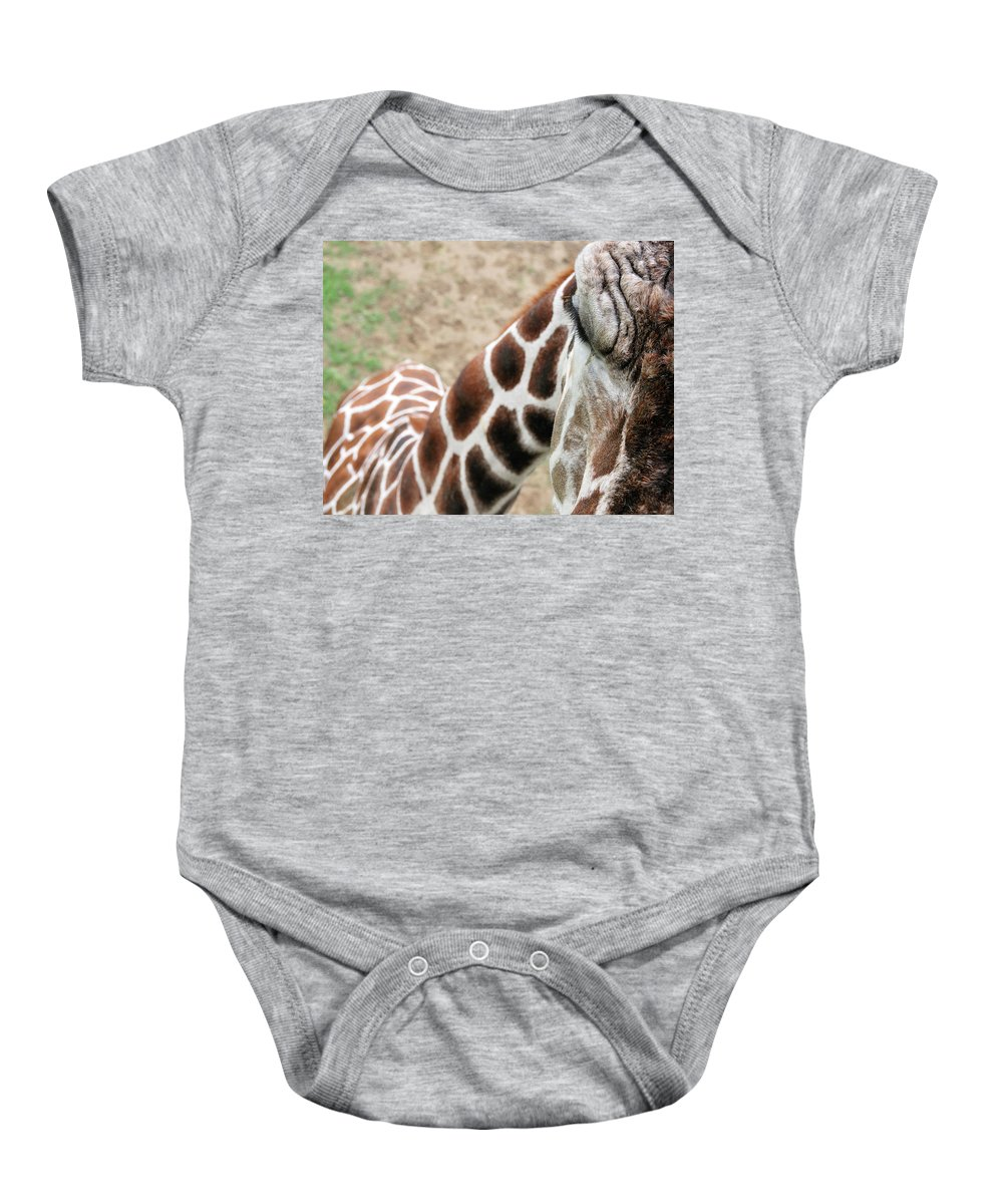 Giraffe Baby Onesie featuring the photograph Eye Of The Giraffe. by David Arment