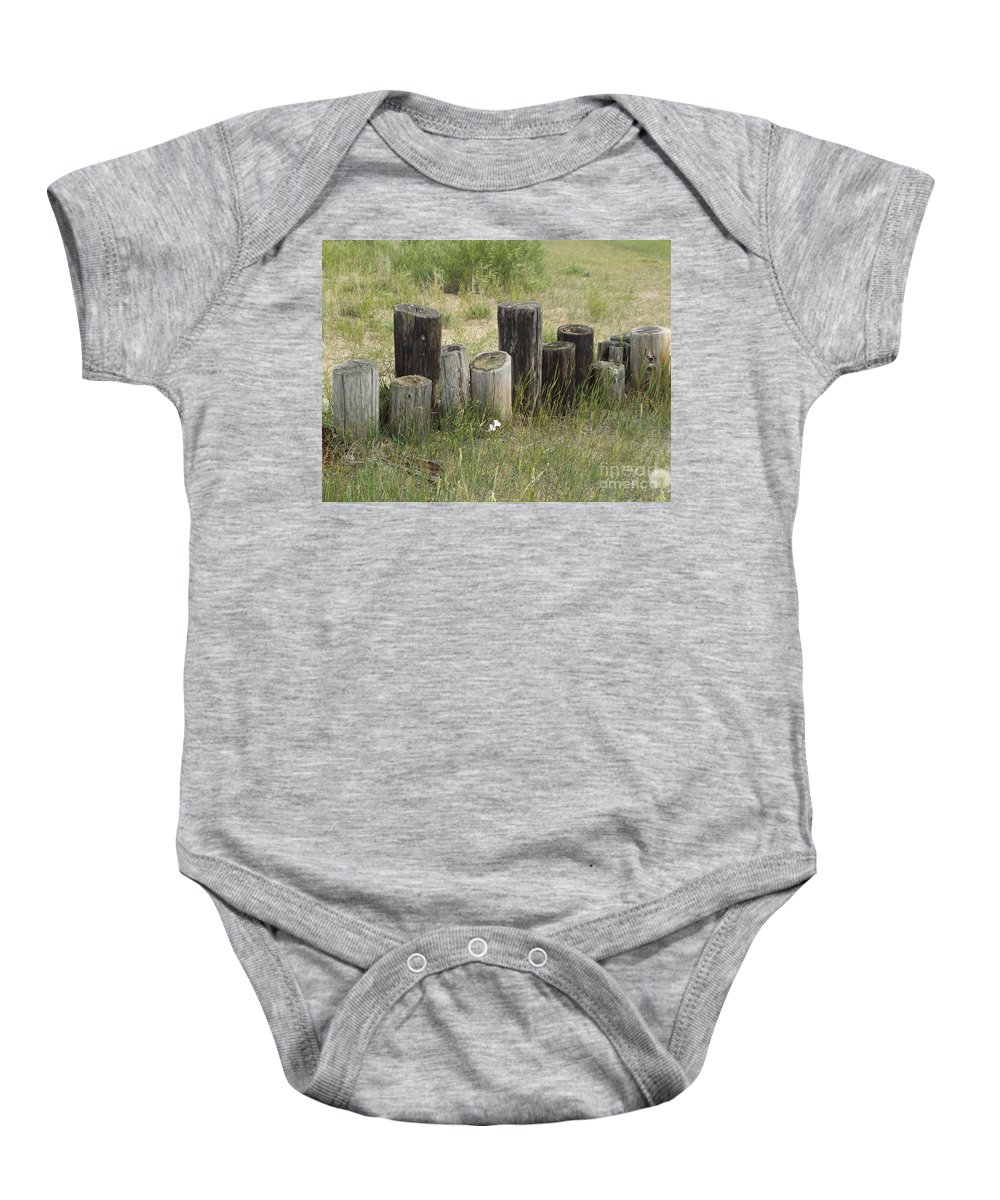 Fence Baby Onesie featuring the photograph Fence Post All In A Row by Erick Schmidt