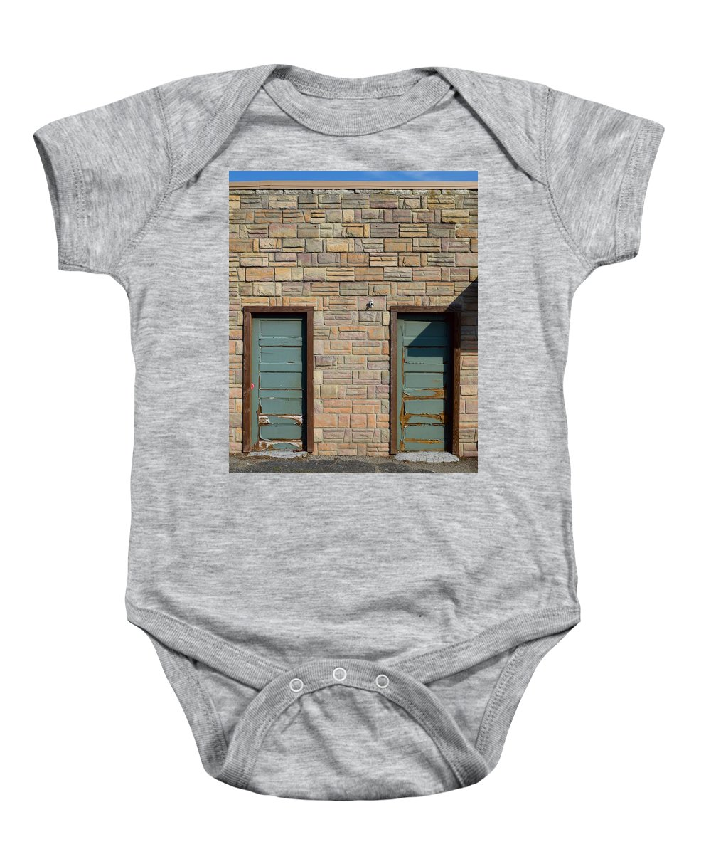 Flagstone Baby Onesie featuring the photograph Flagstone Wall And Two Green Doors by Timothy Smith