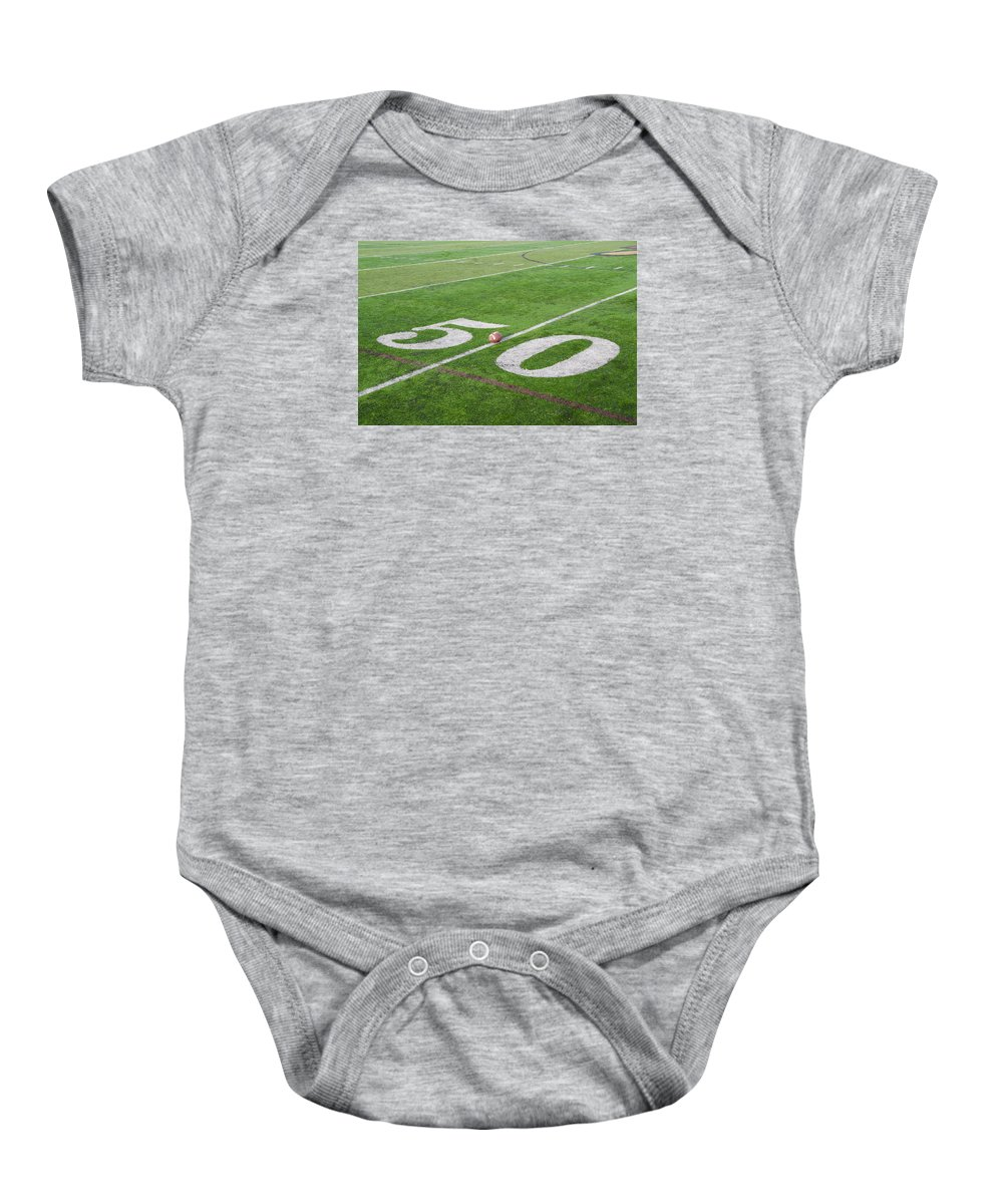 Football Baby Onesie featuring the photograph Football On The 50 Yard Line by Bill Cannon