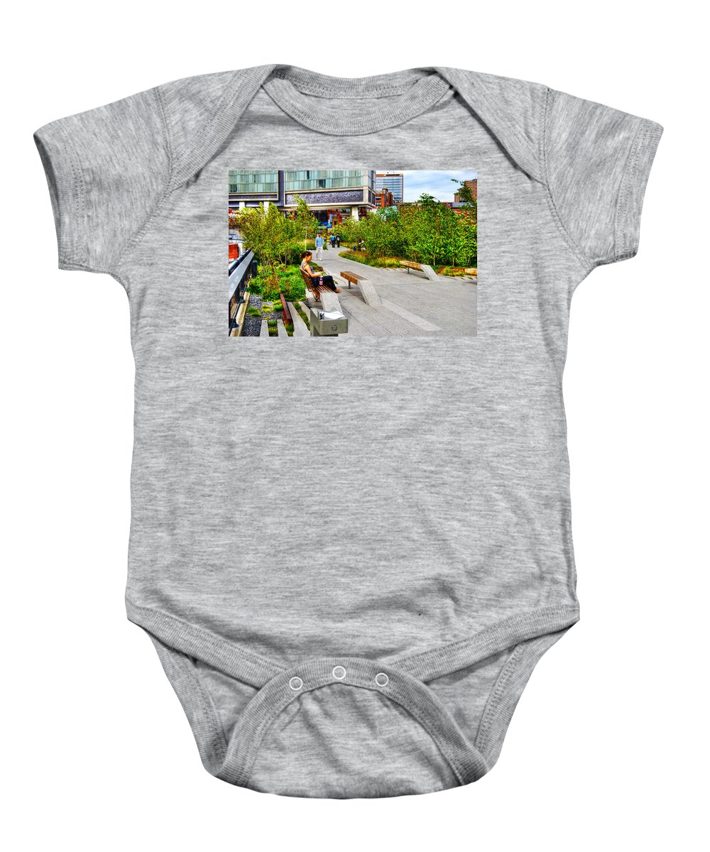 High Line Park Baby Onesie featuring the photograph Girl Uninterrupted On The High Line by Randy Aveille