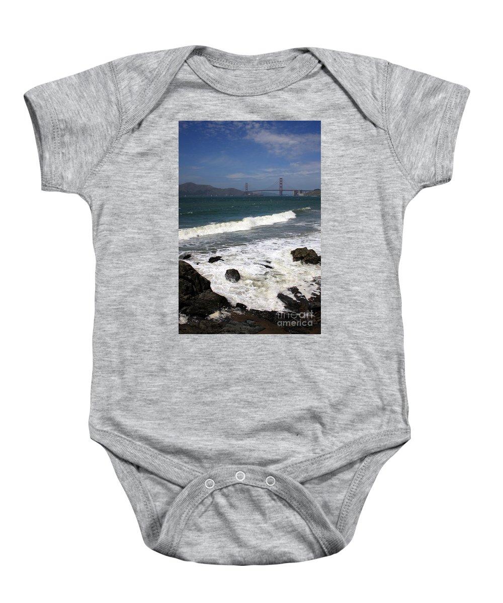 San Francisco Baby Onesie featuring the photograph Golden Gate Bridge With Surf by Carol Groenen