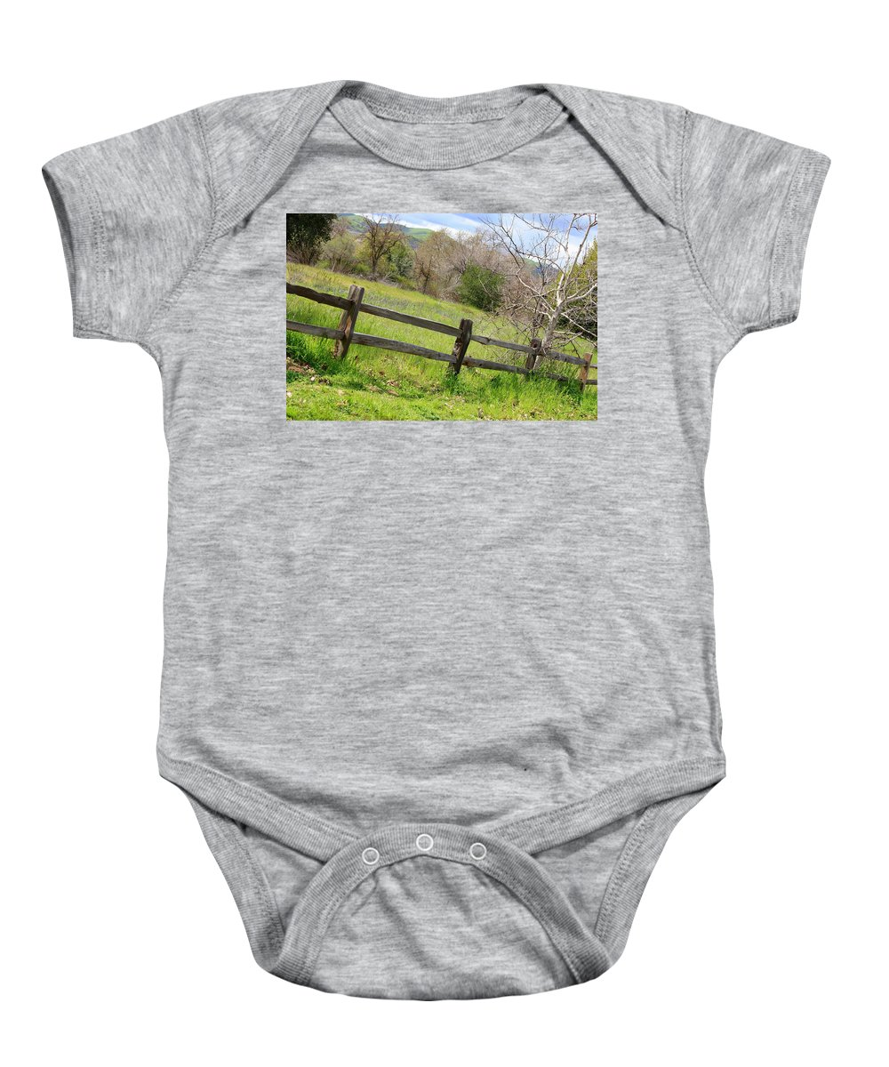 Landscape Baby Onesie featuring the photograph Green Hills And Rustic Fence by Carol Groenen