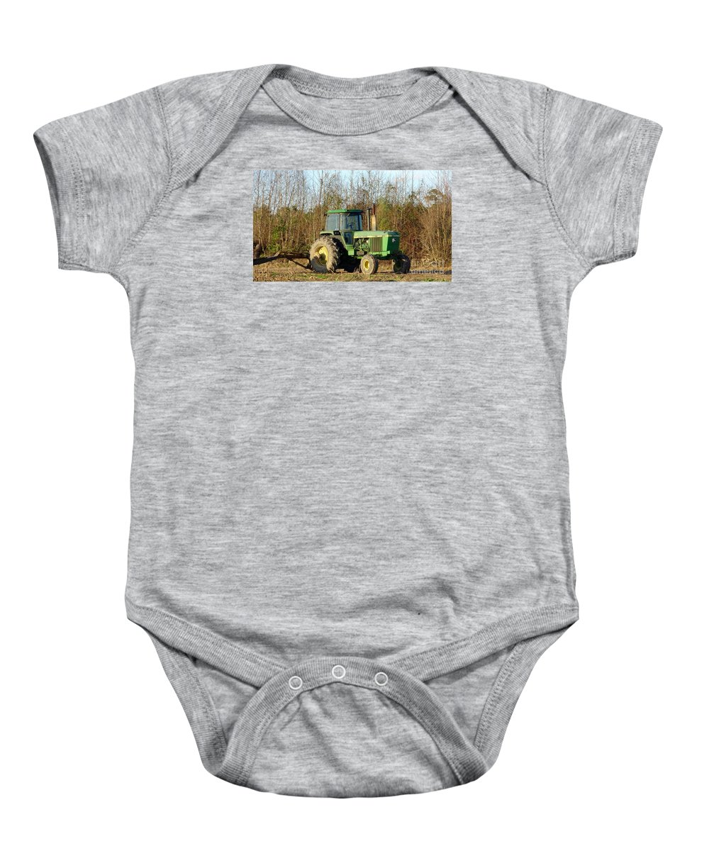 Landscape Baby Onesie featuring the photograph Green Tractor by Karen Francis