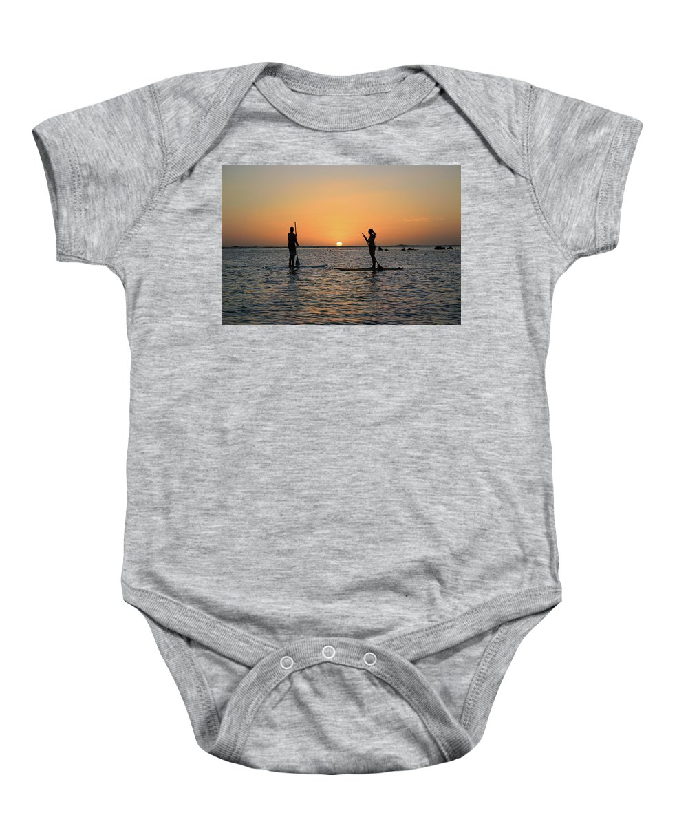 Paddle Board Baby Onesie featuring the photograph Guardians Of Sunlight by Seil Frary