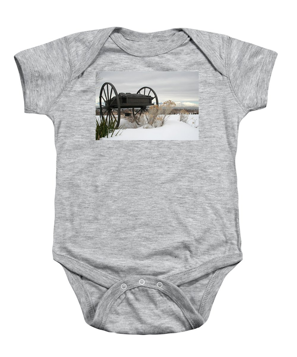 Handcart Baby Onesie featuring the photograph Handcart Monument by Margie Wildblood