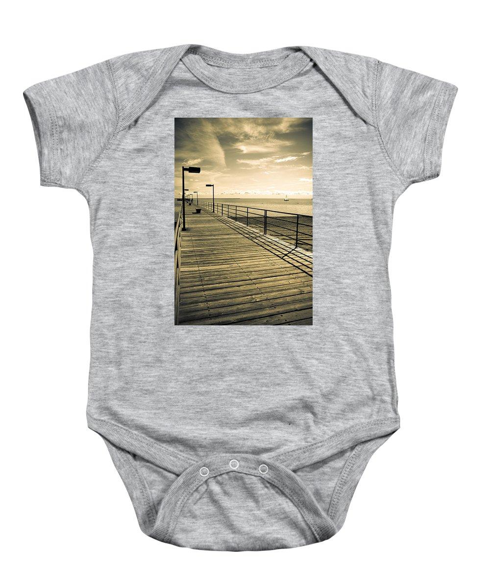 Harbor Baby Onesie featuring the photograph Harbor Beach Michigan Boardwalk by LeeAnn McLaneGoetz McLaneGoetzStudioLLCcom