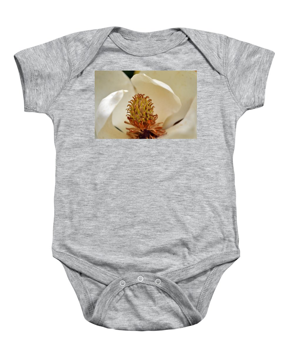 Magnolia Baby Onesie featuring the photograph Heart Of Magnolia by Larry Bishop