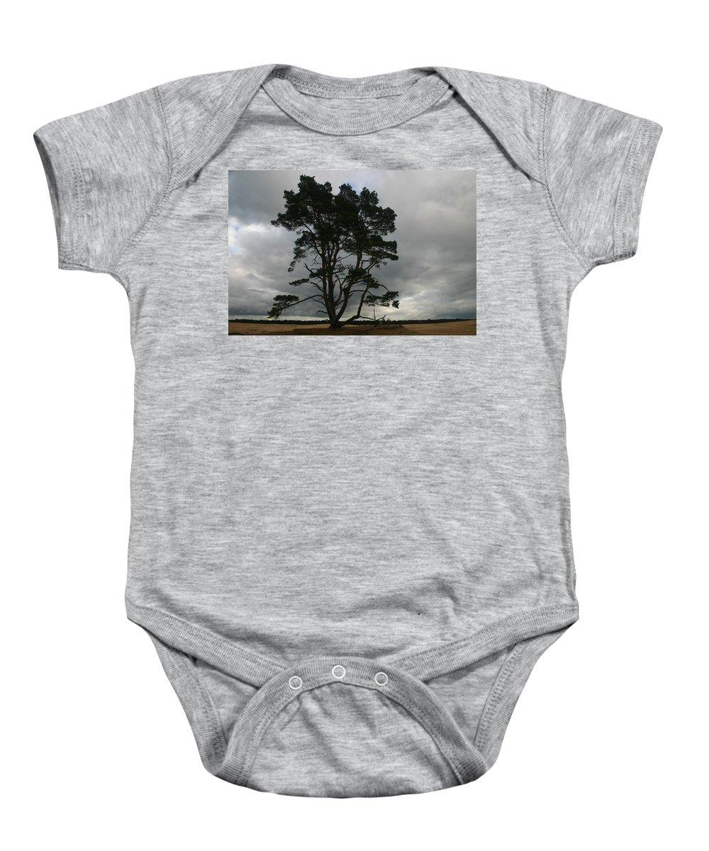 Storm Baby Onesie featuring the photograph Holland Desert by Minaz Jantz