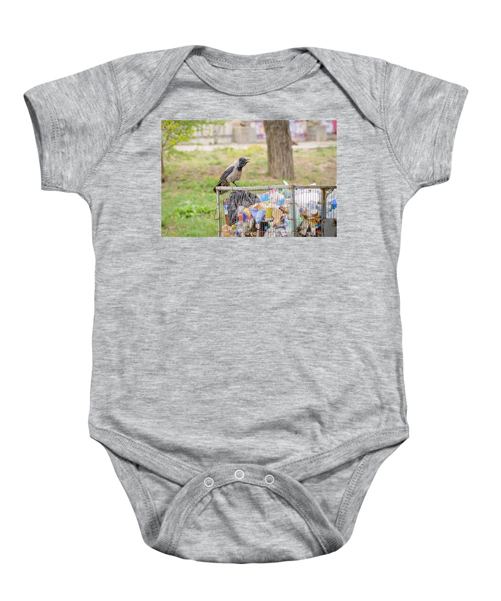 Hooded Crow Baby Onesie featuring the photograph Hooded Crow With Garbage by Alain De Maximy