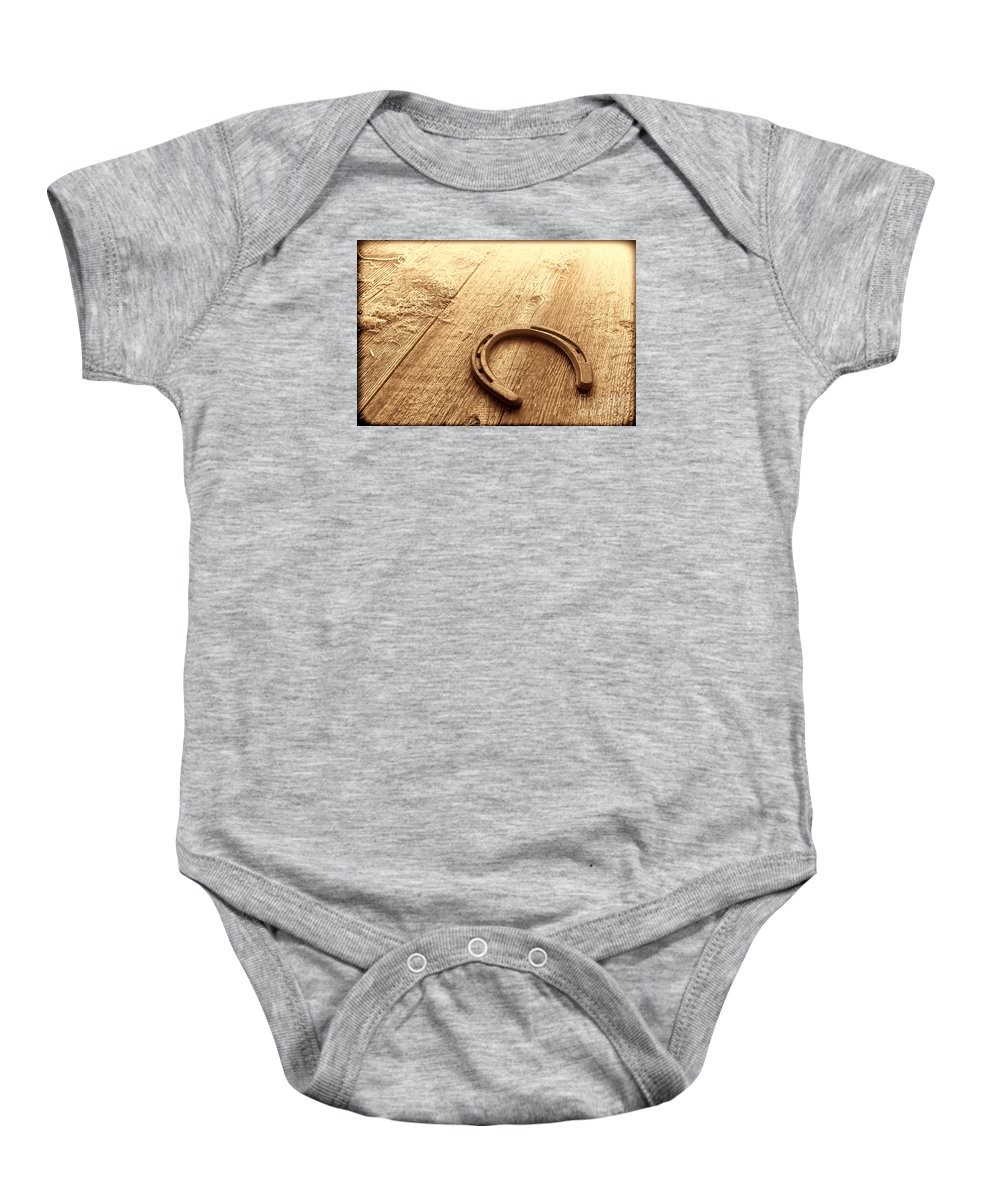 Horseshoe Baby Onesie featuring the photograph Horseshoe On Barn Floor by American West Legend By Olivier Le Queinec