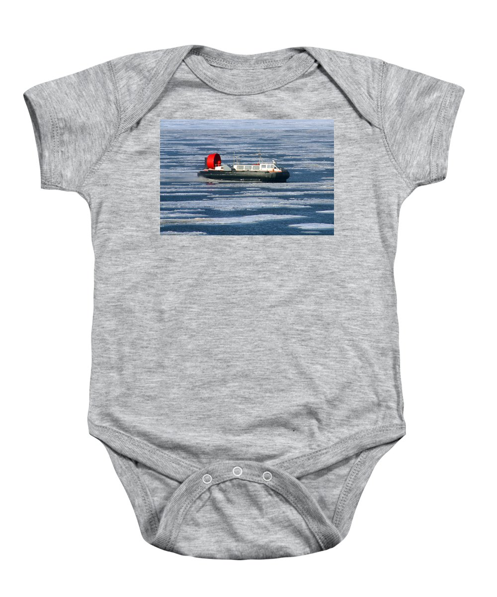 Arctic Ocean Baby Onesie featuring the photograph Hovercraft On Frozen Artic Ocean by Anthony Jones