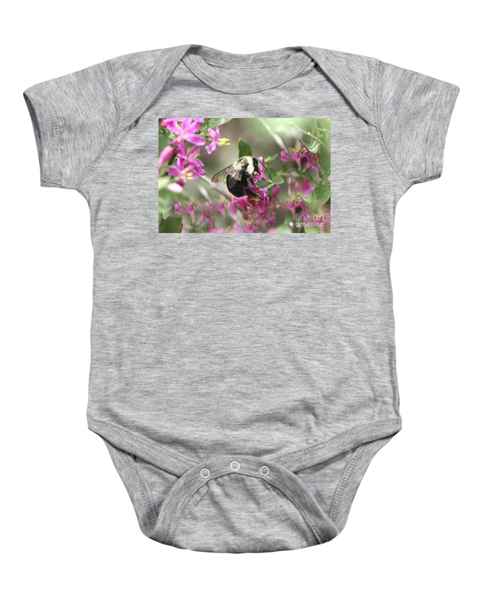 Flower Baby Onesie featuring the photograph In The Center Of Pink by Deborah Benoit