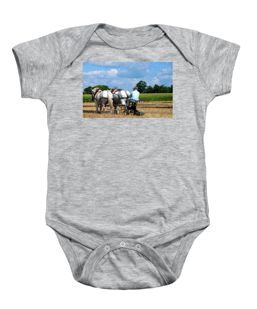 Plowing Baby Onesie featuring the photograph In The Groove by Ian MacDonald