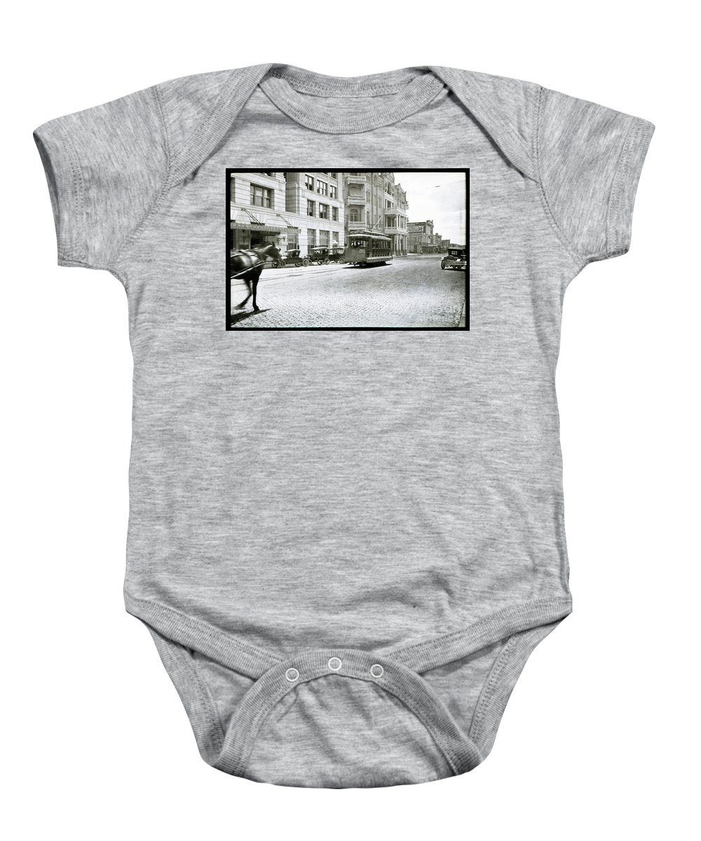 In This 1913 Photo Baby Onesie featuring the photograph In This 1913 Photo, A Cable Car Drives Past The Littlefield Building And Dristill Hotel On Sixth Str by Austin Welcome Center