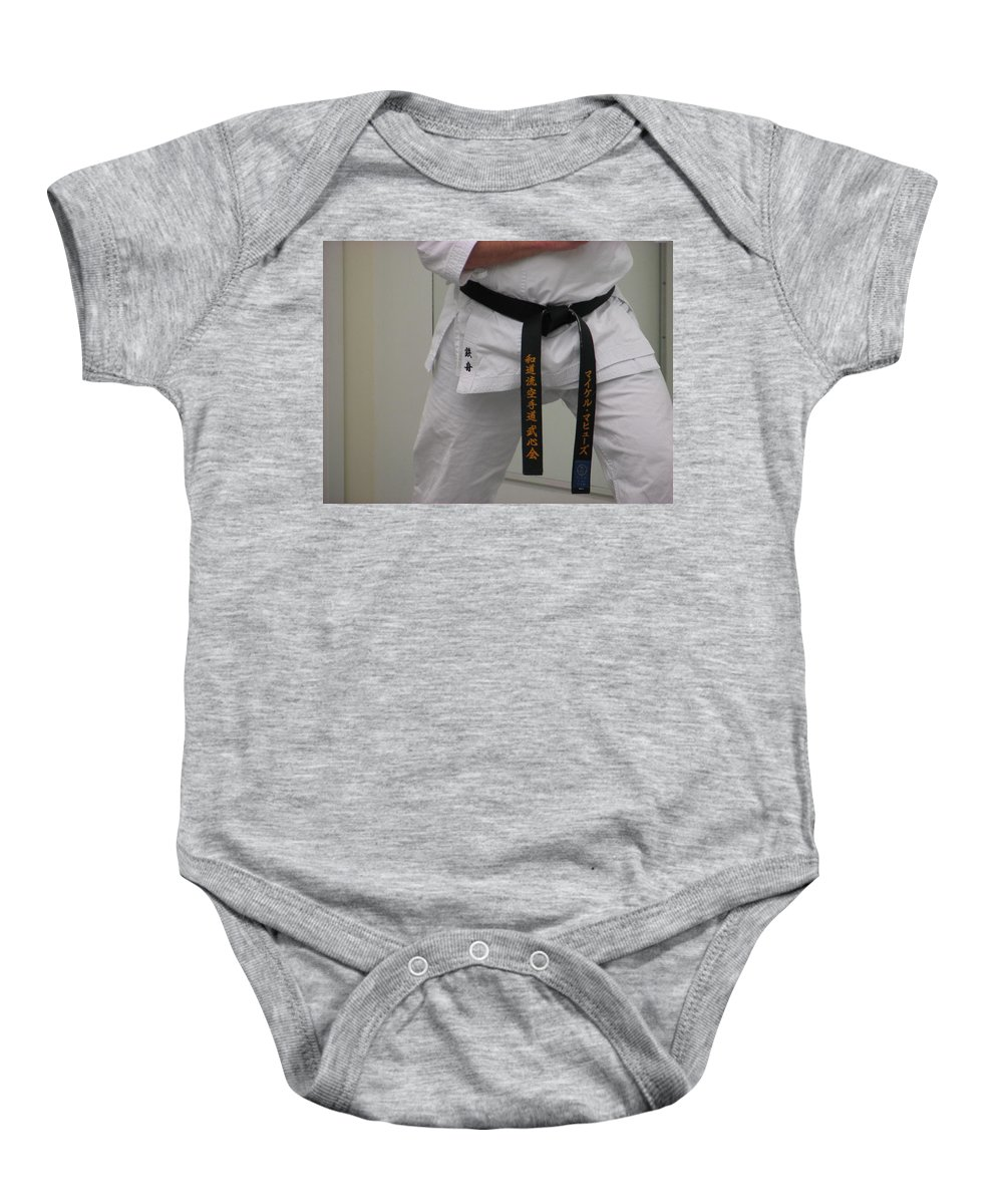 Karate Baby Onesie featuring the photograph Kata by Kelly Mezzapelle