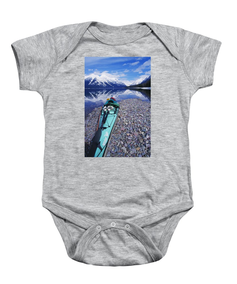 Adventure Baby Onesie featuring the photograph Kayak Ashore by Bill Brennan - Printscapes