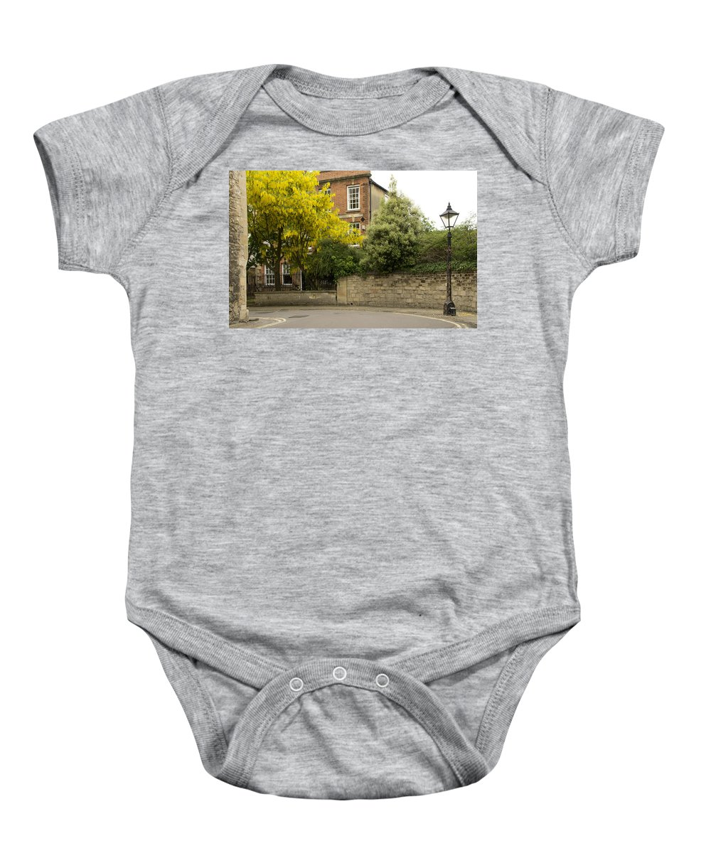 Lamppost Baby Onesie featuring the photograph Lamppost On A Street Bend. by Elena Perelman
