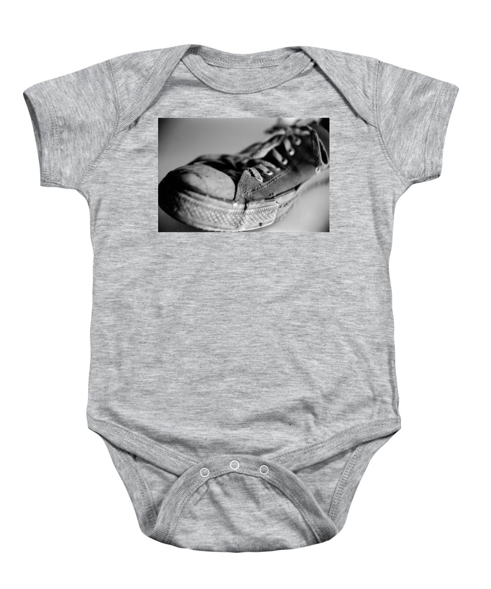 Chuck Taylor Baby Onesie featuring the photograph Last Leg by Jeffery Ball