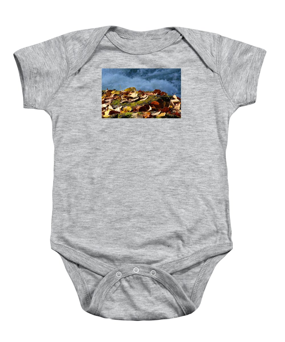 Fall Baby Onesie featuring the photograph Leaves On Rock By River by Ed Mosier
