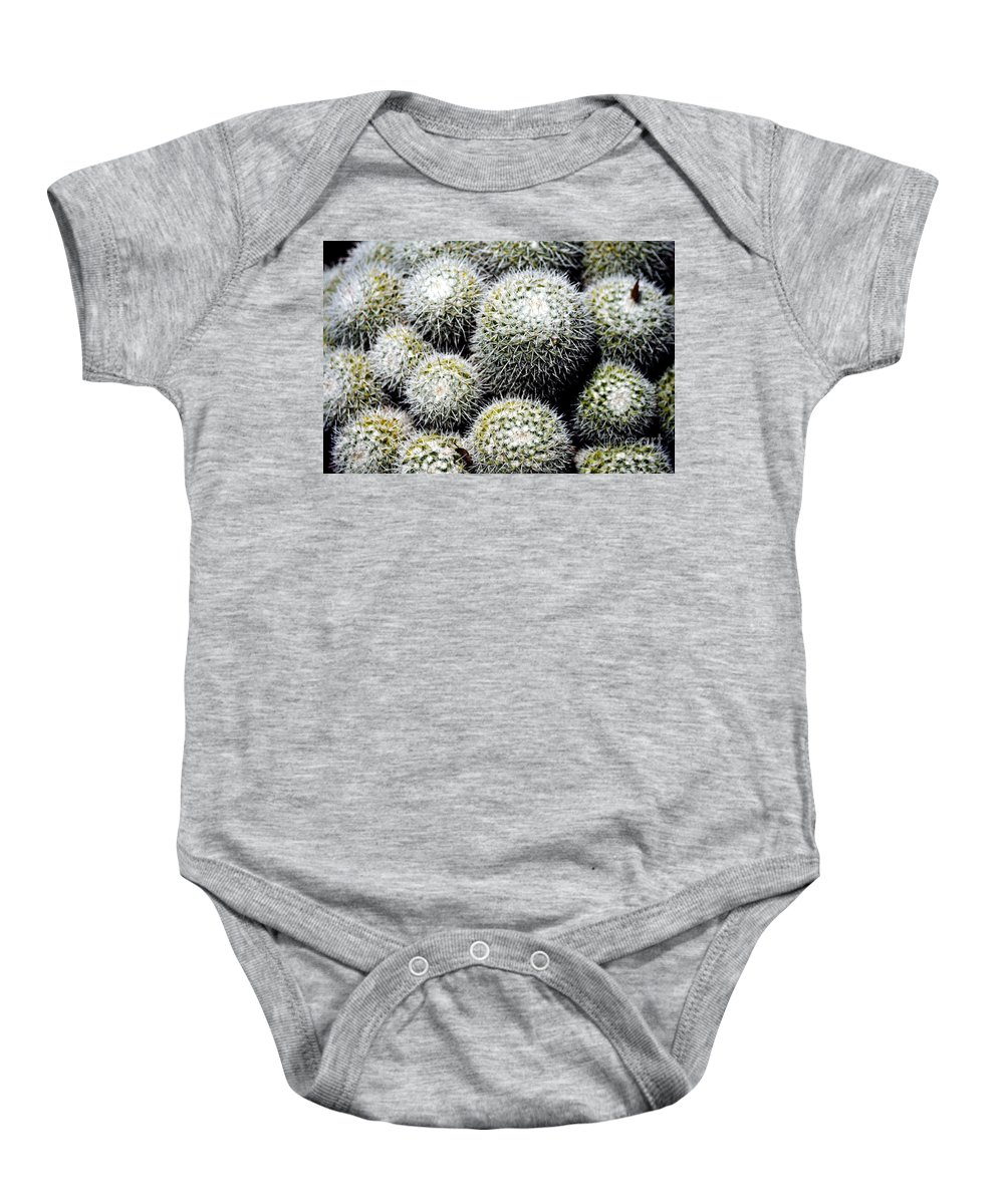 Clay Baby Onesie featuring the photograph Life Sucs by Clayton Bruster