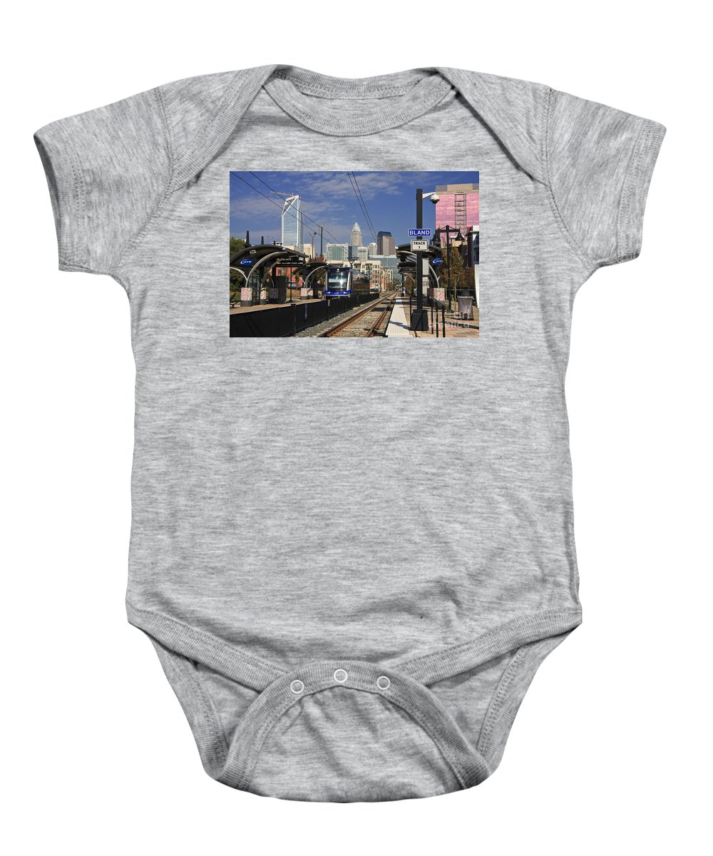 Lynx Baby Onesie featuring the photograph Light Rail In Charlotte by Jill Lang