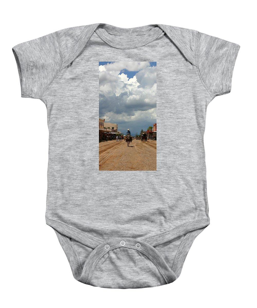 Arizona Baby Onesie featuring the photograph Lone Rider by Joe Kozlowski