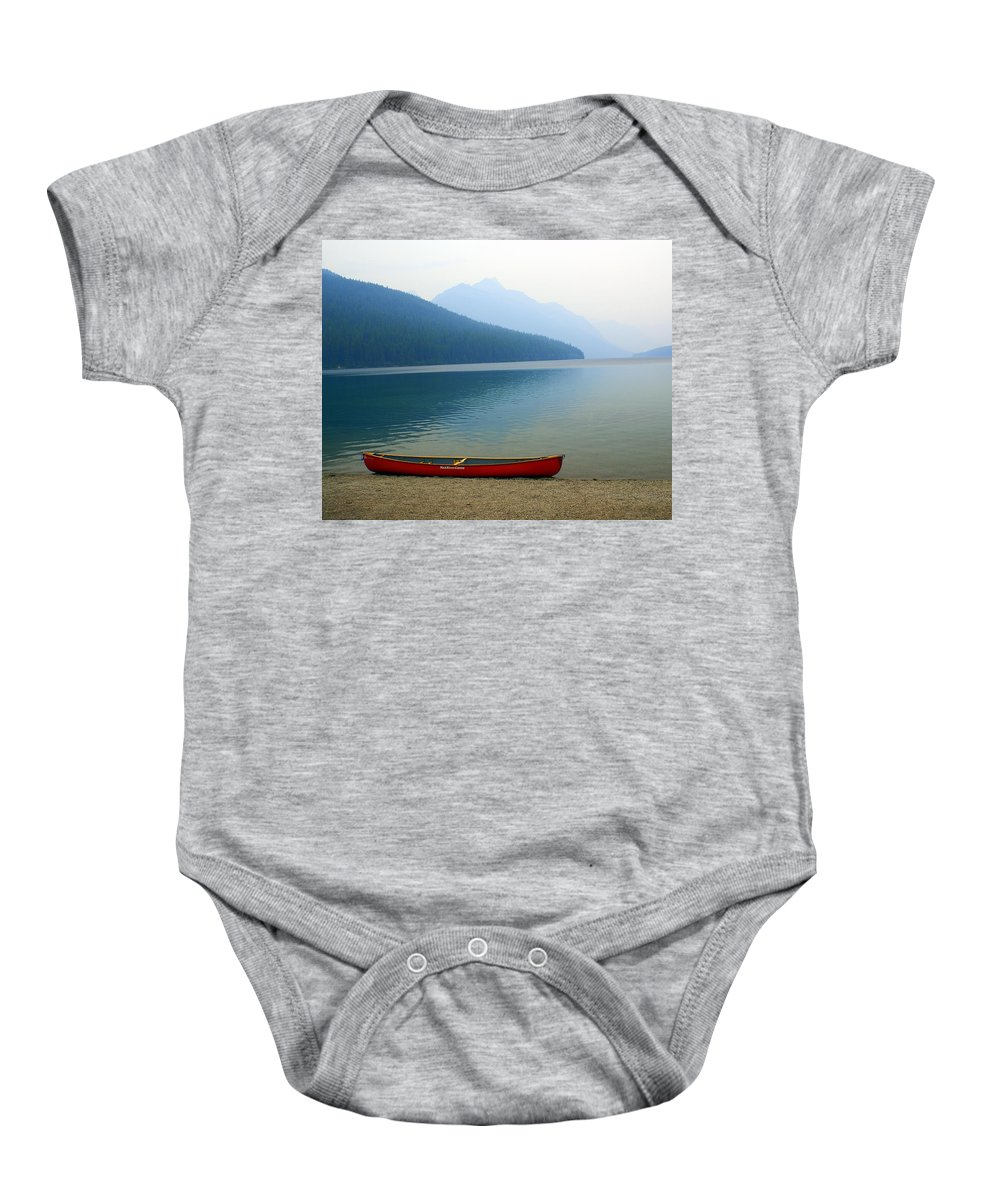 Glacier National Park Baby Onesie featuring the photograph Lonly Canoe by Marty Koch