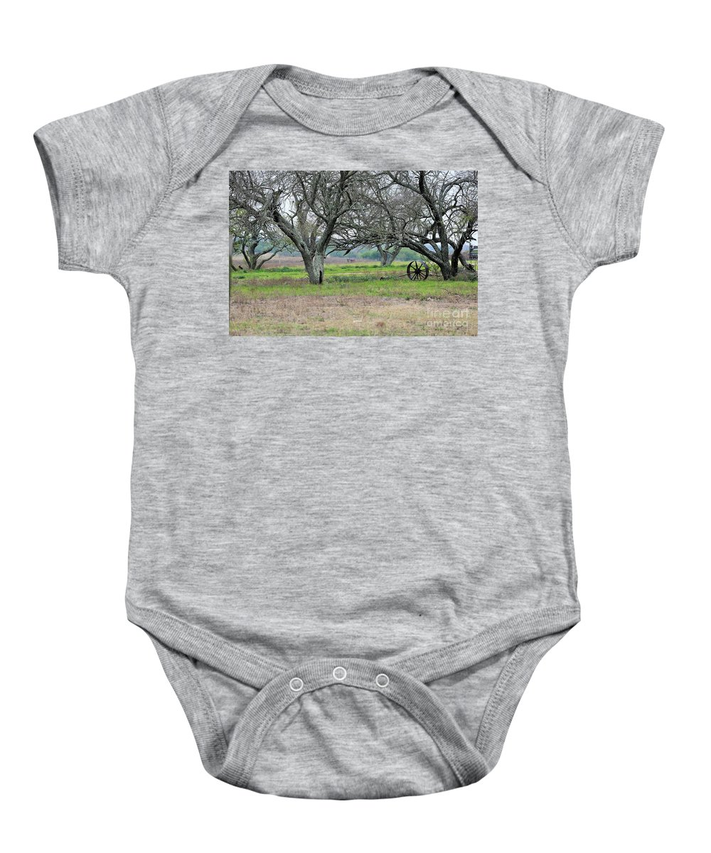 Baby Onesie featuring the photograph Lost Wheel 2 by Jeff Downs
