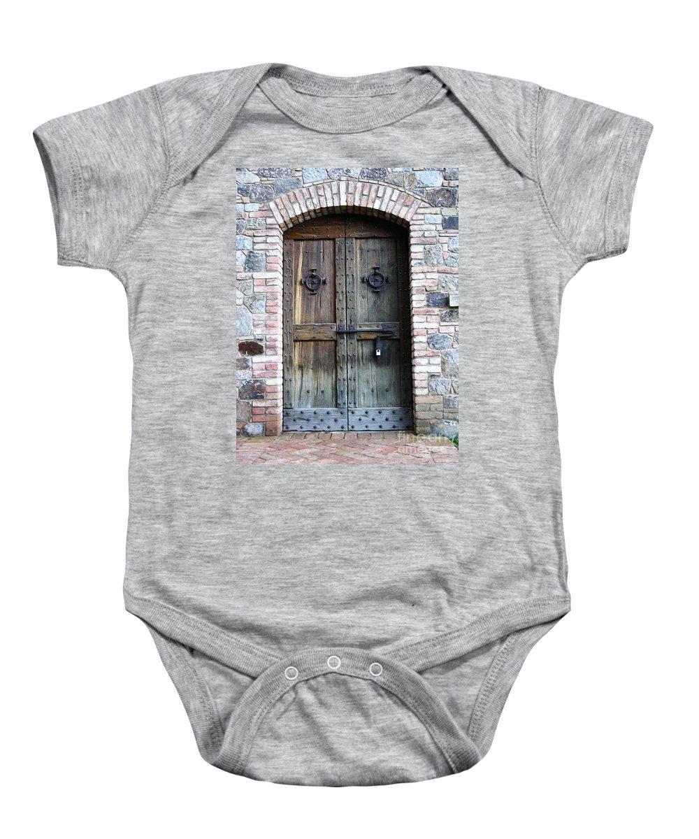 Door Baby Onesie featuring the photograph Medieval Door by Carol Groenen
