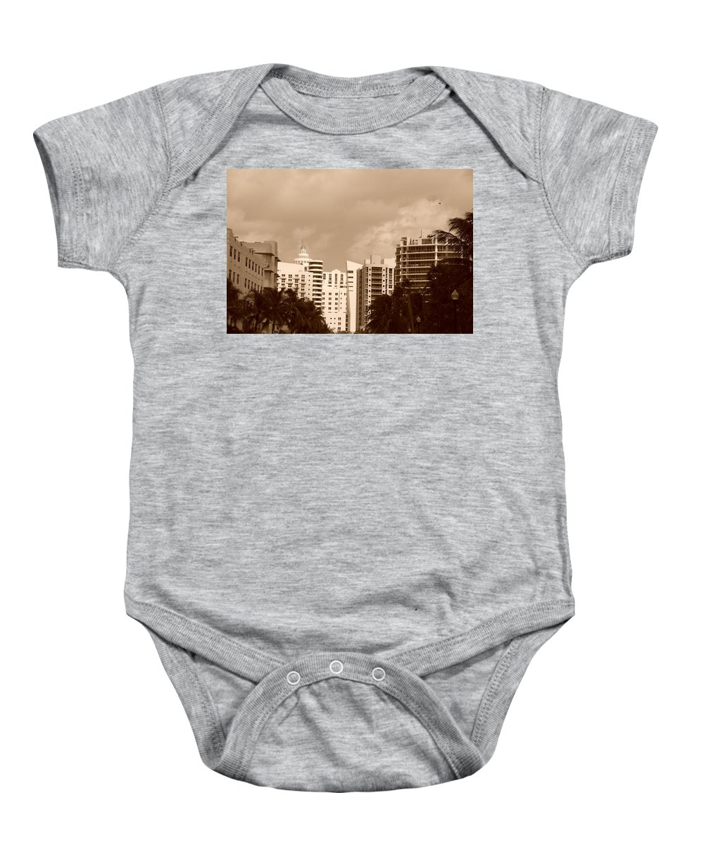 Sepia Baby Onesie featuring the photograph Miami Sepia Sky by Rob Hans
