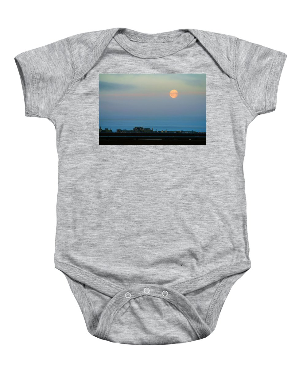 Landscape Baby Onesie featuring the photograph Moon Over Flow Station 1 by Anthony Jones