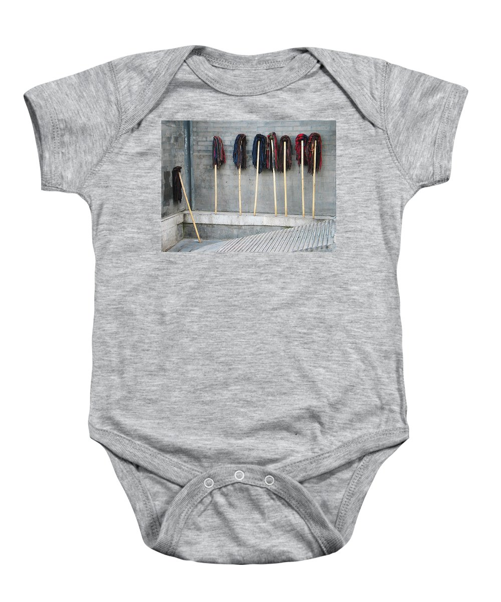 Line Up Baby Onesie featuring the photograph Mop Court by Xueling Zou