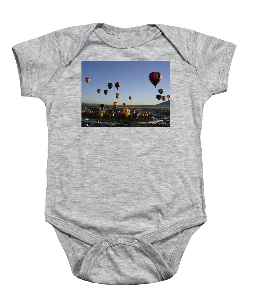 Hot Air Balloons Baby Onesie featuring the photograph Morning Liftoff by Mary Rogers