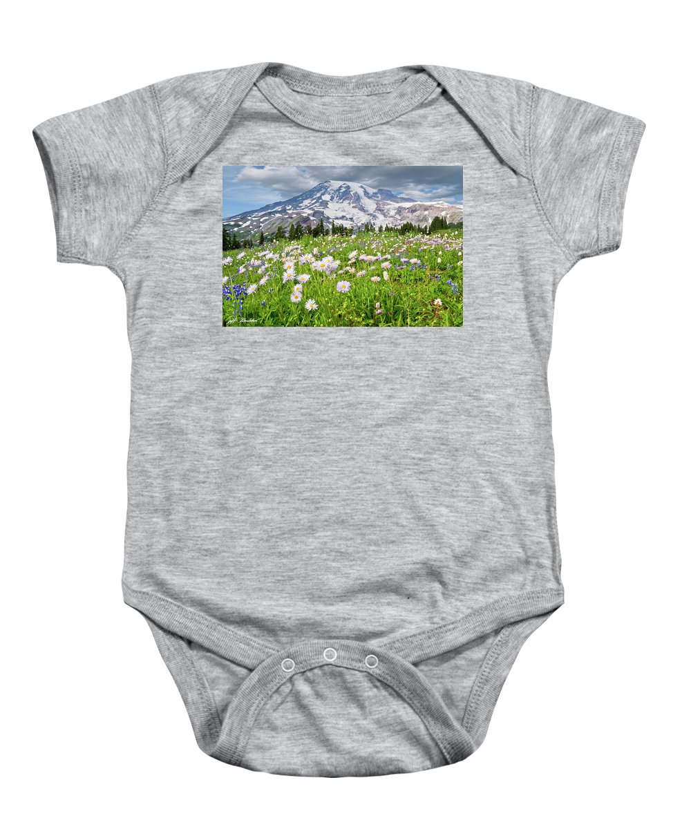Alpine Baby Onesie featuring the photograph Mount Rainier And A Meadow Of Aster by Jeff Goulden