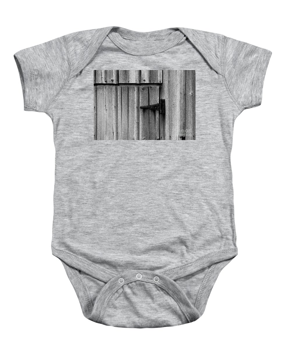 Old Baby Onesie featuring the photograph Old Barn Door by Timothy Johnson