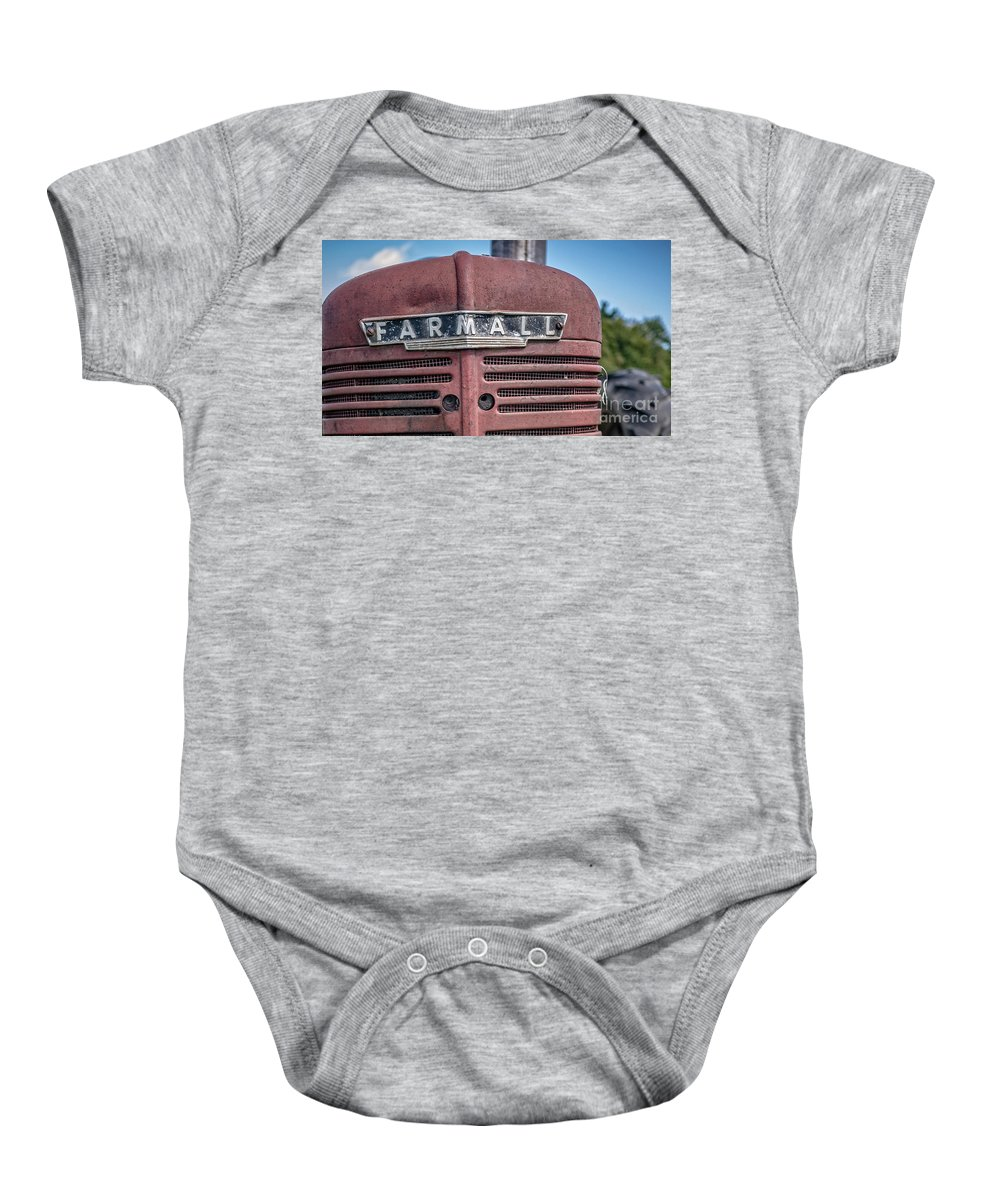 Tractor Baby Onesie featuring the photograph Old Farmall Tractor Grill And Nameplate by Edward Fielding