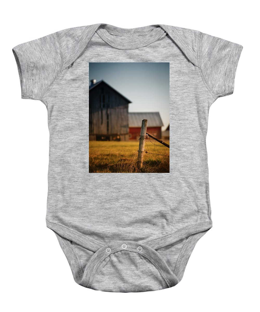 Fence Post Baby Onesie featuring the photograph Old Fence With A Red Barn by David Jilek
