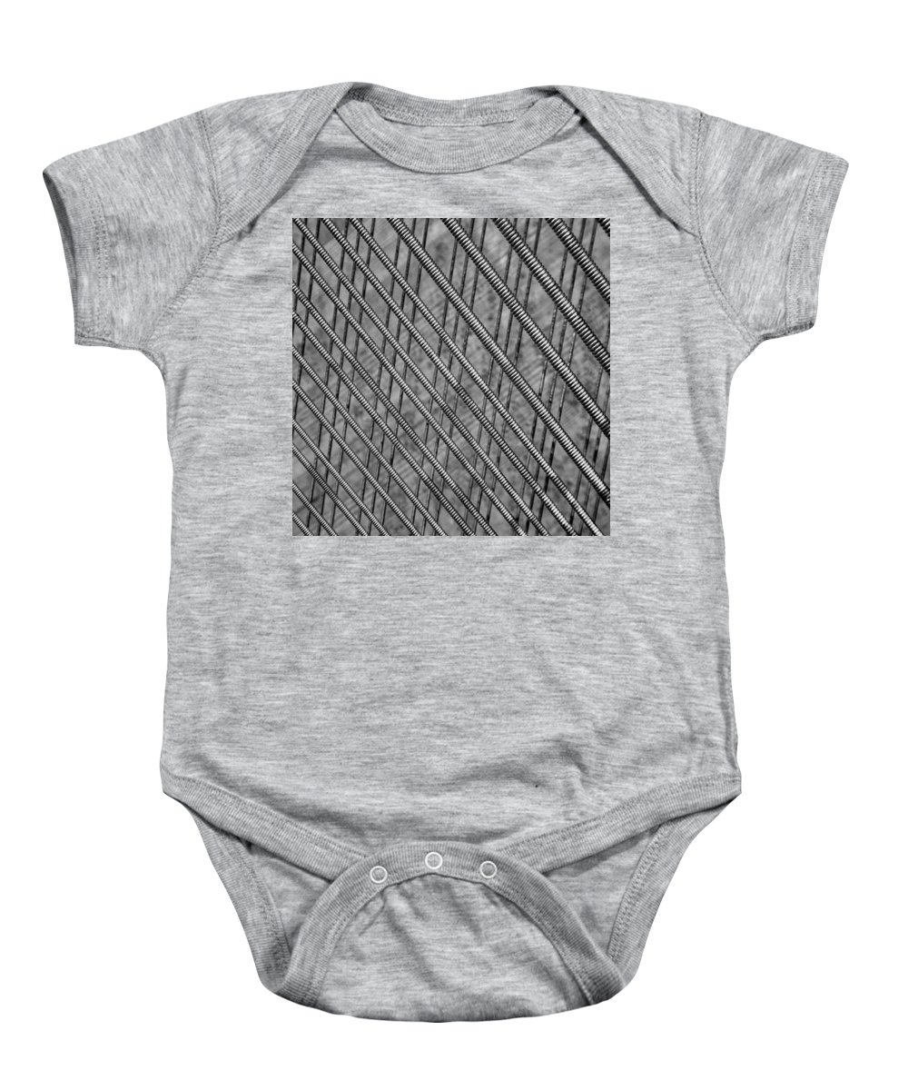 Mono Baby Onesie featuring the photograph Old Piano Strings by Russ Dixon
